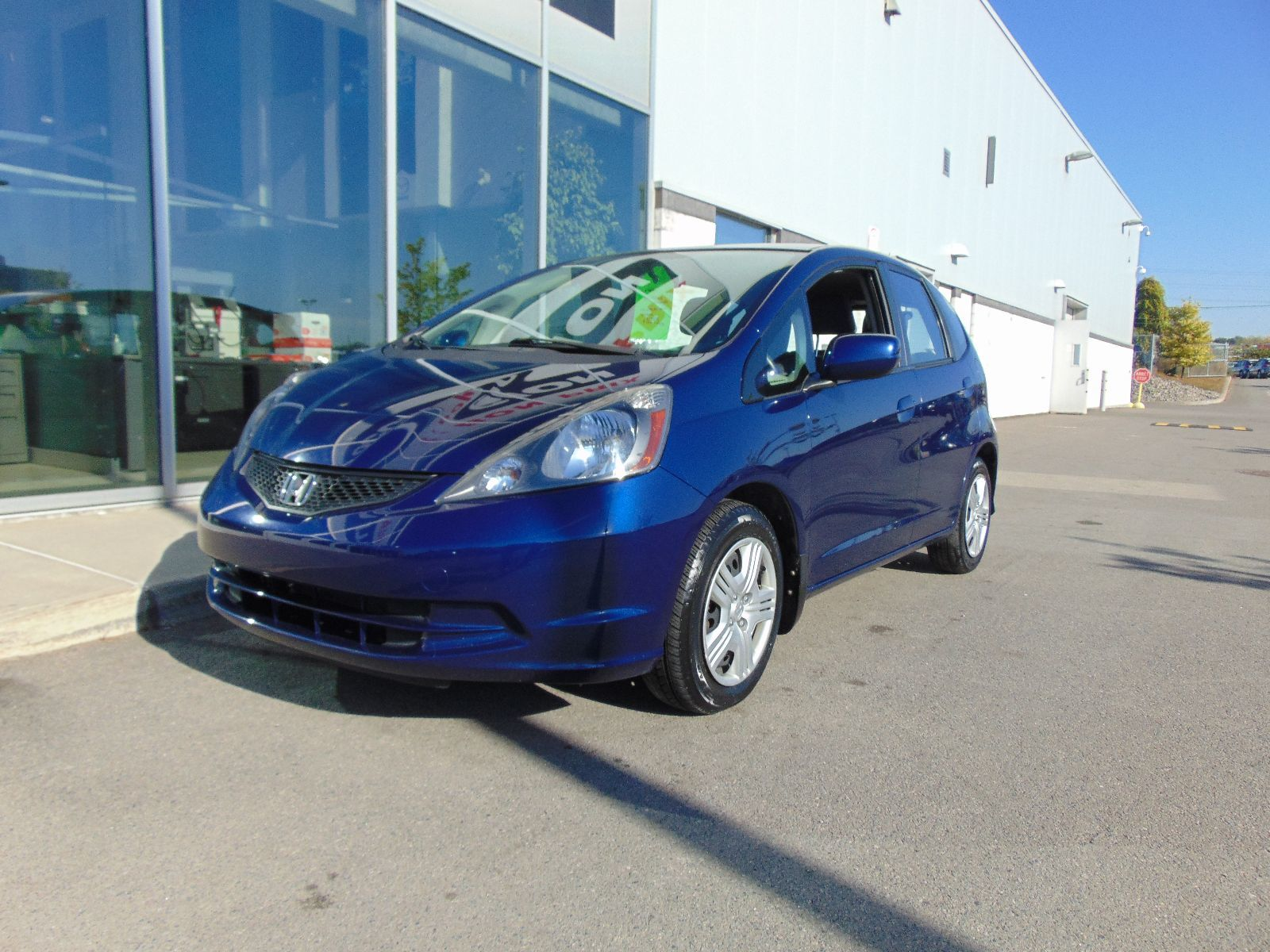 Used 2013 honda fit deal pending lx ac bas km in montreal for Honda fit deals